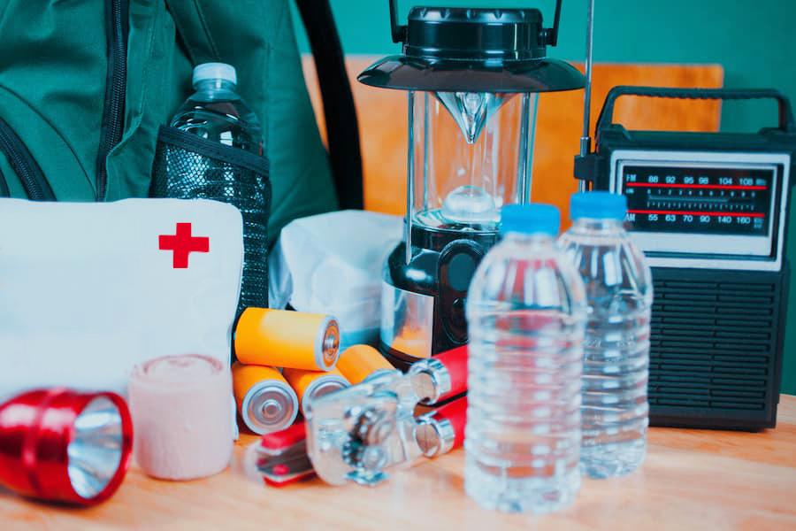 Emergency preparedness items such as first aid kit, water, radio, batteries.