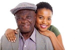 An elderly man with his daughter