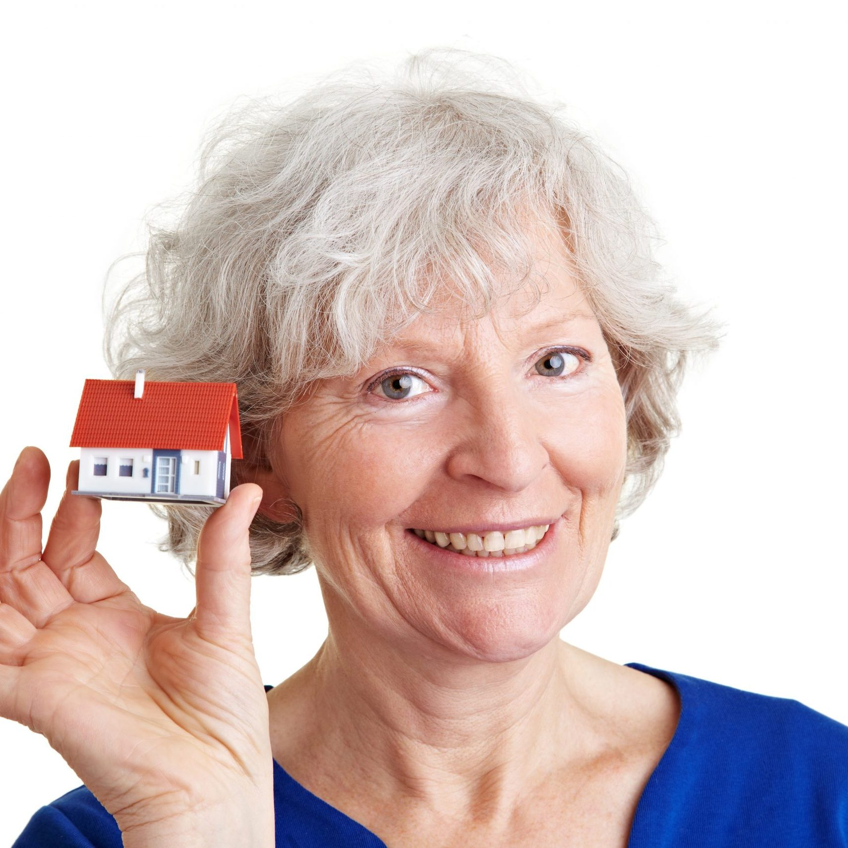 A senior lady holding a small toy house