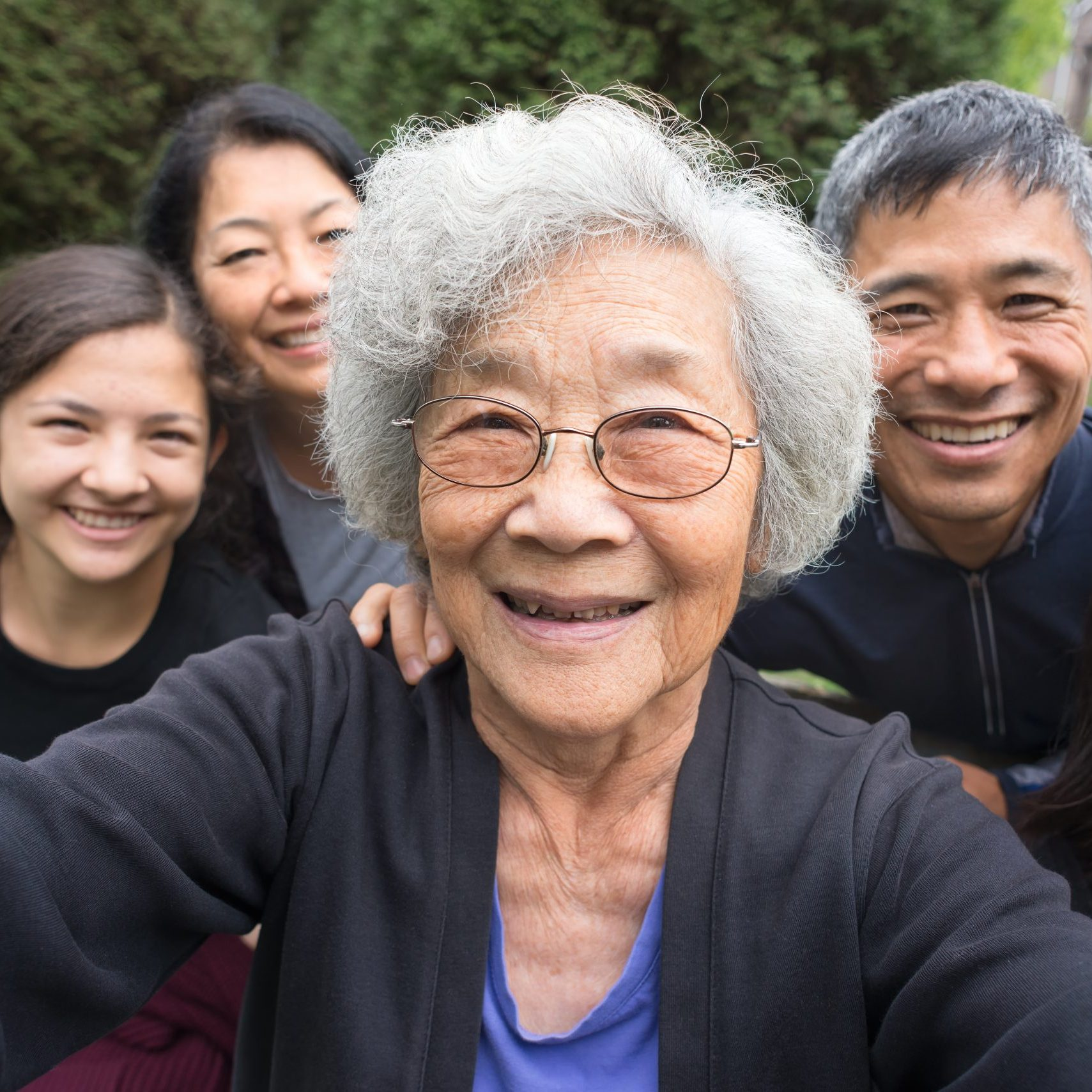 An old lady with her family behind